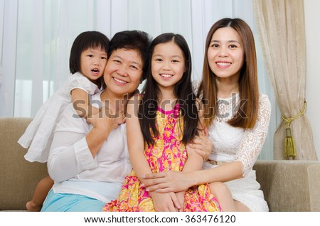 Indoor portrait of asian senior woman together with daughter and grandchildren