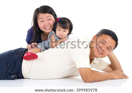 Indoor portrait of beautiful asian family - stock photo