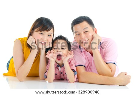 Indoor portrait of beautiful asian family lying on the floor