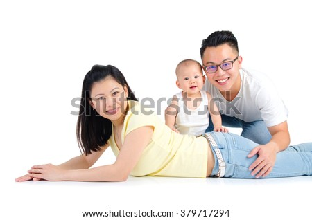 Indoor portrait of beautiful asian family on white background - stock photo