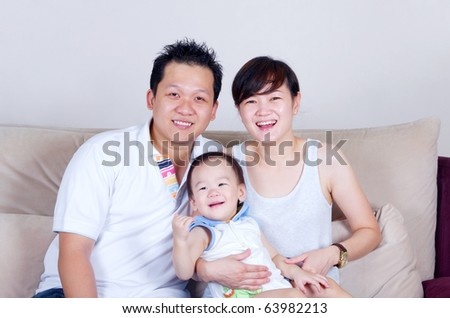 indoor portrait of happy asian family - stock photo