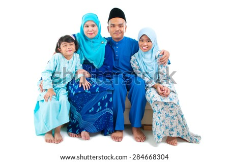 Indoor portrait of malay family - stock photo