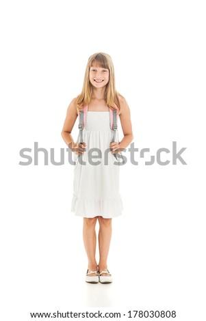 Indoor shot of a cute Caucasian schoolgirl. - stock photo