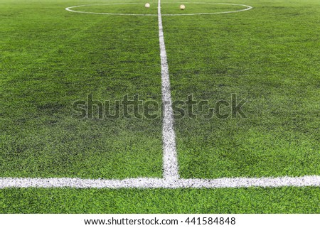 Indoor soccer (football) field with white chalk line marking