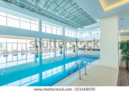Indoor swimming pool in healthy concept - stock photo