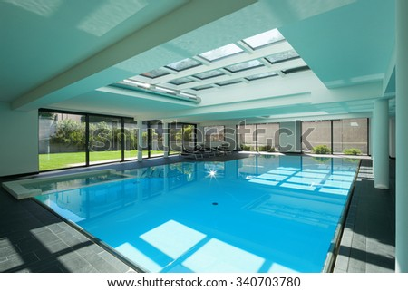 indoor swimming pool of a modern house with spa - stock photo