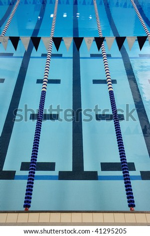 Indoor Swimming Pool with Lane Lines and Backstroke Flags - stock photo