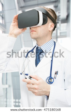 Indoors shot of doctor wearing virtual reality glasses