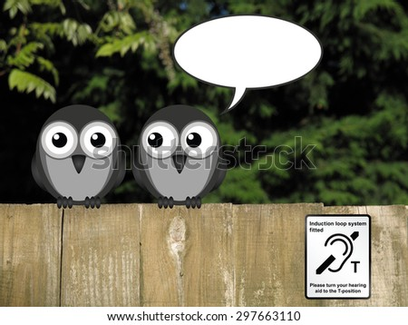 Induction Loop System sign with copy space speech bubble and birds perched on a timber garden fence against a foliage background                                - stock photo