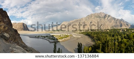 Indus River Panorama in the Karakorum Mountain Range in Northern Pakistan - stock photo