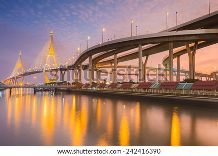 Industrail Ring Bridge across the river at twilight time with water reflexion, Bangkok Thailand - stock photo