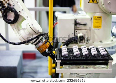Industrail Robotic Arm for holding a package - stock photo