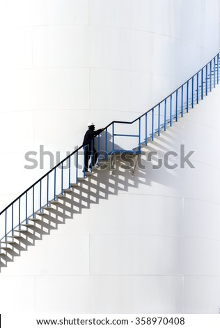 Industrial abstract,Stairway on exterior of refinery storage tank - stock photo
