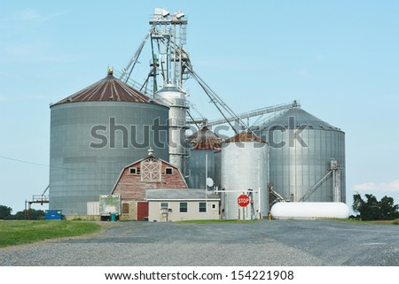 Industrial Agriculture Silo with Harvested Grain  - stock photo