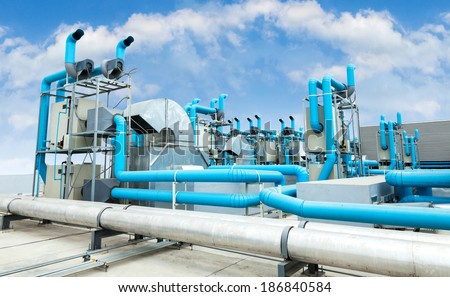 Industrial air conditioner on the roof with blue sky - stock photo