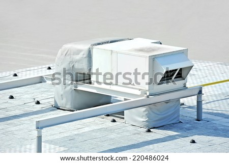 Industrial air conditioning and ventilation systems on a roof - stock photo