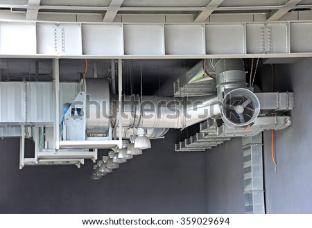 Industrial air conditioning and ventilation systems under roof - stock photo