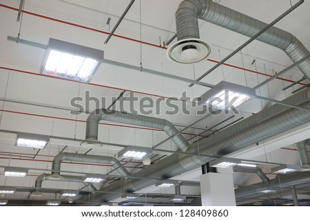 industrial air conditioning system and air diffusers - stock photo