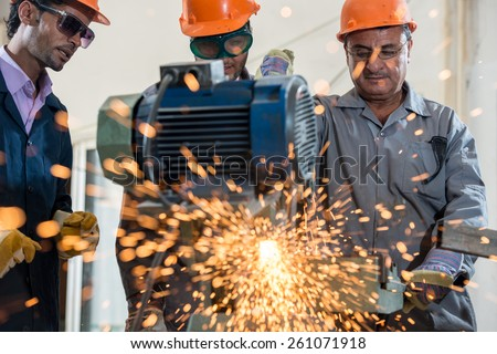 Industrial background. Welder in a factory - stock photo