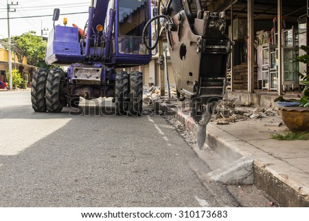 industrial backhoe, bulldozer moving drilling for road construction updates.