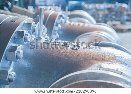 Industrial big dimentions gate valves with neeple for a safaty valve, with focus on first gate valve - stock photo