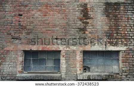 Industrial brick building wall with windows. Vintage effect.
