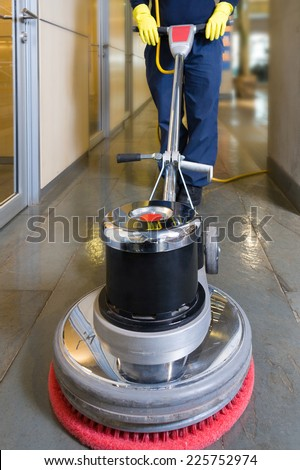 Industrial buffing machine polishing the floor in a hallway - stock photo