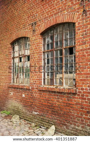 Industrial building brick wall with two windows
