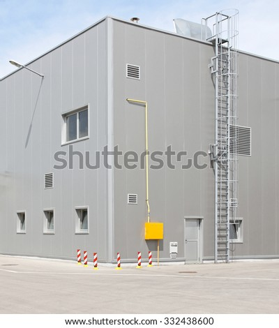Industrial Building Corner With Safety Ladder - stock photo