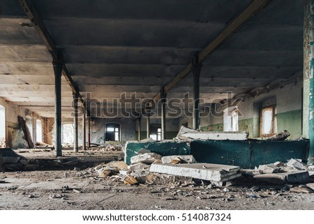 Industrial building interior of abandoned wharehouse in dark colors