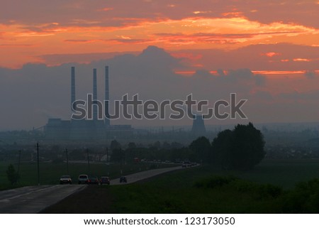 industrial building on the background of bright orange sky