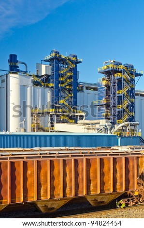 Industrial Building over railway cars. - stock photo