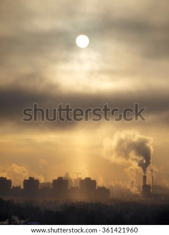 Industrial buildings at sunset sky       - stock photo