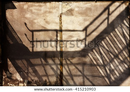 industrial buildings shadows on the wall of an old factory