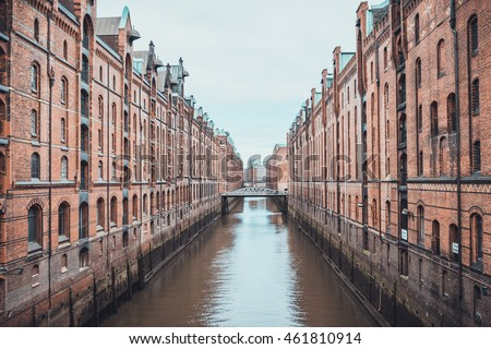 Industrial canal and red brick Gothic style port warehouses in Speicherstadt, Hamburg Germany in a travel and tourism concept
