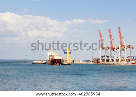 Industrial carrier big ship in port, beautiful blue sea