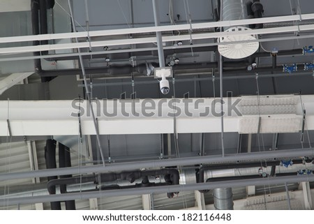 Industrial ceiling with camera, ventilation system of modern building