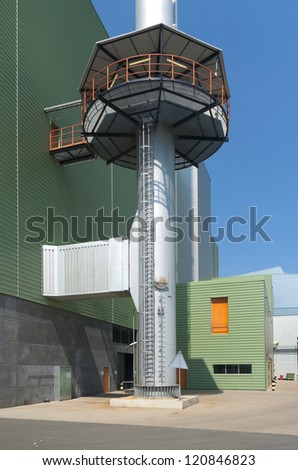 industrial chimney on the area of an waste treatment plant