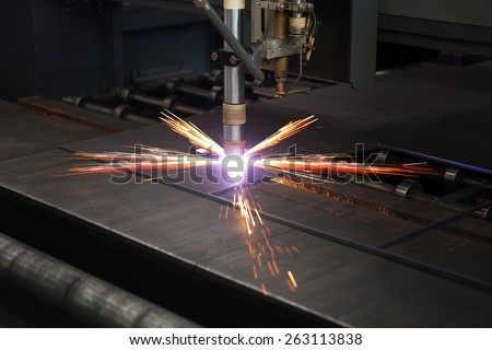 Industrial cnc plasma cutting of metal plate - stock photo