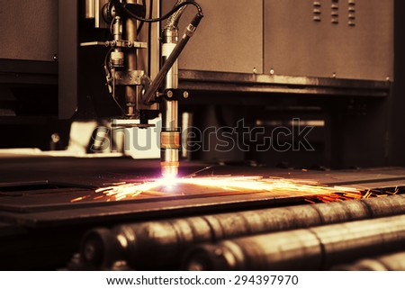 Industrial cnc plasma machine cutting of metal plate - stock photo