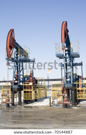 Industrial construction and mechanism. Work of oil industry - stock photo