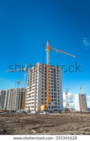 Industrial construction cranes and construction of houses - stock photo