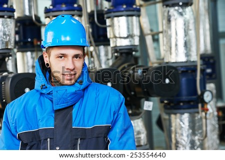 industrial construction worker plumber  at boiler room - stock photo