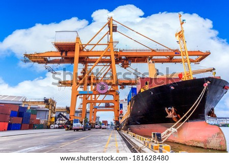 Industrial Container Cargo freight ship with working at port  - stock photo