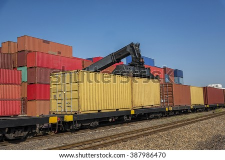 Industrial Container Cargo with working crane to railway transportation to habour in Logistic Import Export area