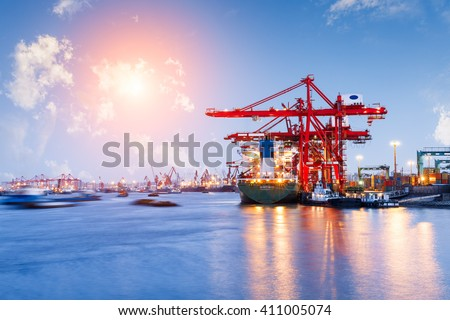 Industrial container freight Trade Port scene at sunset - stock photo