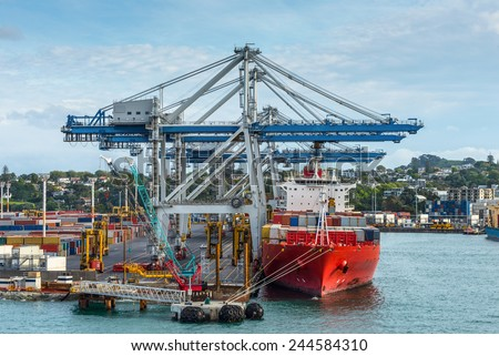 Industrial Container ship in the harbor - international freight shipping, Auckland, New Zealand - stock photo