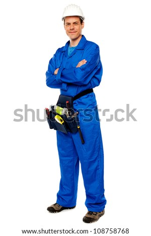 Industrial contractor posing with crossed arms isolated over white background - stock photo