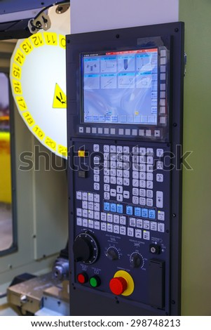industrial control panel of the machine with monitor and keyboard