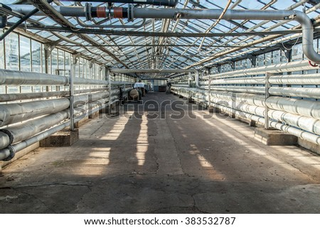 Industrial corridor with tubing inside greenhouse heating system
